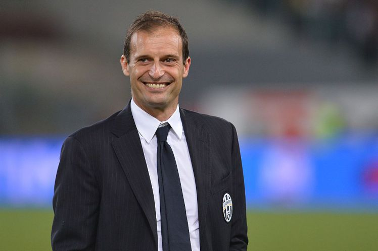 Juventus' coach Massimiliano Allegri smiles after winning 2-1 the Italian Tim Cup final match (Coppa Italia) between Juventus and Lazio on May 20, 2015 at the Stadio Olimpico in Rome. AFP PHOTO / ALBERTO PIZZOLI (Photo credit should read ALBERTO PIZZOLI/AFP/Getty Images)