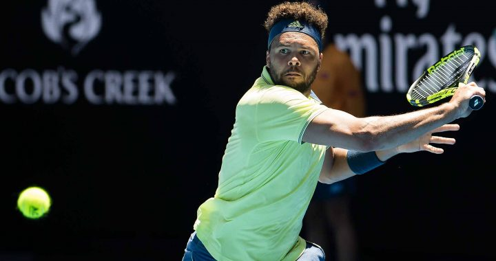 jo tsonga tennis player doing a backhand